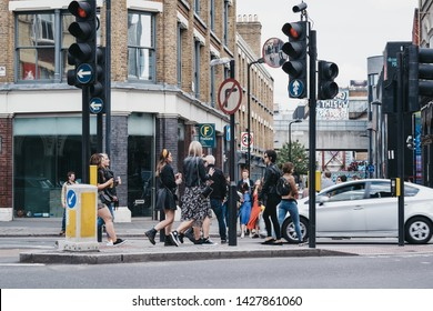 London, UK - June 15, 2019: People walking on a street in Shoreditch, a trendy area of Londons East End that is home to an array of markets, bars and restaurants.