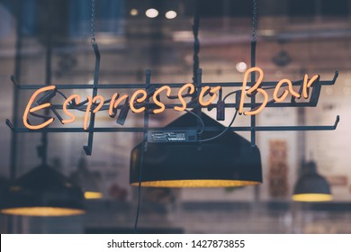 London, UK - June 15, 2019: Espresso neon sign on a cafe inside Spitalfields Market, one of the finest Victorian Market Halls in London with stalls offering fashion, antiques and food.