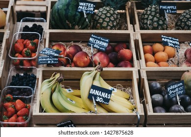 London, UK - June 15, 2019: Fresh fruits in wooden crates on sale at Spitalfields Market, one of the finest surviving Victorian Market Halls in London with stalls offering fashion, antiques and food.