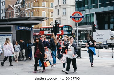 London, UK - June 15, 2019: People walking on a street past Aldgate East, an Underground station on Whitechapel High Street in Aldgate area of Spitalfields named after nearby ward of Aldgate.