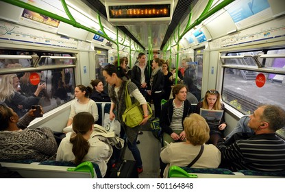 London, UK - June 16, 2015: People ride a Victoria Line underground train. Opened in 1863, the London Underground carried a record 1.26 billion passengers in the year 2013-2014.