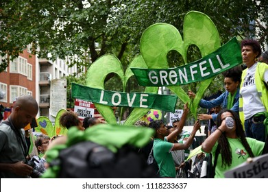 London, UK June 16, 2018 Thousands march and rally in Westminster demanding justice for Grenfell Tower fire victims, marking the one year anniversary of the tragedy which killed seventy two people