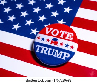 London, UK - June 16th 2020: Vote Trump pin badge, pictured over the United States of America flag.