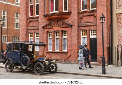 LONDON, UK - JUNE 17, 2013: a retro movie scene with old-timer car and couple on a street