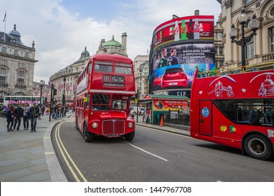 London, UK, June 17, 2016: Famous English Old Double Decker bus and red taxi in street of London