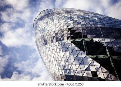 LONDON, UK - JUNE 17TH 2016: Looking up at the magnificent Gherkin skyscraper (30 St. Mary Axe) in the City of London on 17th June 2016.