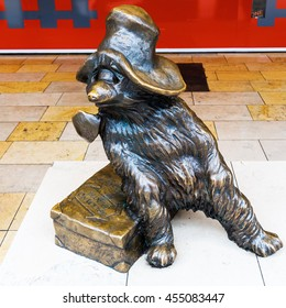 London, UK - June 19,2016: Paddington Bear statue at Paddington station. It is a fictional character, featured in more than twenty books written by Michael Bond, illustrated by Peggy Fortnum and other