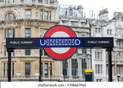 London, UK - June 2015: Underground sign captured at Trafalgar square. London architecture as a background.