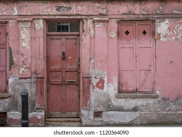 London UK, June 2018. Exterior facade of red / pink painted traditional Huguenot weaver's house at 4 Princelet Street, Spitalfields, East End. Frontage is weathered and peeling, but characterful.