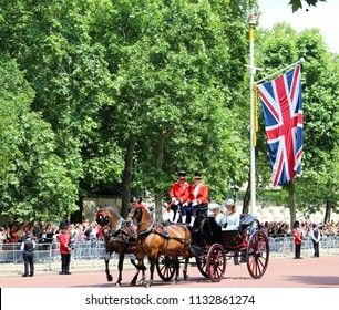 London, UK - June 2018: Kate Middleton and Camilla travelling in horse-drawn carriage along The Mall towards Buckingham Palace during Trooping the Colour parade. June 09, 2018.
