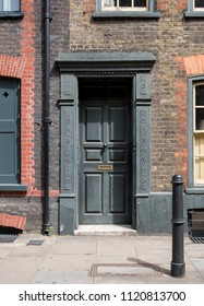 London UK, June 2018. Painted doorway at entrance to traditional Huguenot weaver's house on Princelet Street, Spitalfields, East London.
