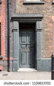 London UK, June 2018. Painted doorway at entrance to traditional Georgian Huguenot weaver's house on Princelet Street, Spitalfields, East London.