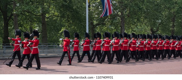 London UK, June 2018. Panorama of Guardsmen marching down the The Mall, Westminster during the Trooping the Colour queen's birthday parade. British flags hang above.