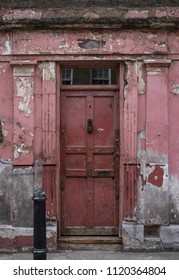 London UK, June 2018. Part of the exterior of red / pink painted traditional Georgian Huguenot weaver's house at 4 Princelet Street, Spitalfields, East London. Frontage is weathered and dilapidated.