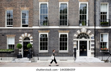 London, UK, June 2019:  central London at Victoria with traditional brick buildings and  people rushing on the street