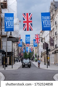 London UK. June 2020. New Bond Street, iconic luxury shopping street, photographed during Coronavirus pandemic, with banners thanking the NHS and key workers for their dedication during the outbreak.