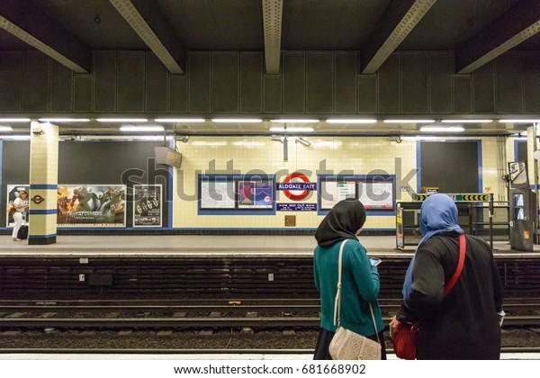 London, UK - June 21, 2017 - Two Muslim women waiting on the platform at Aldgate East tube station