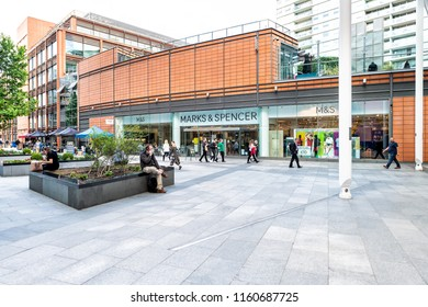 London, UK - June 21, 2018: Marks & Spencer store, shop with people sitting, walking on sidewalk in plaza near Victoria underground station