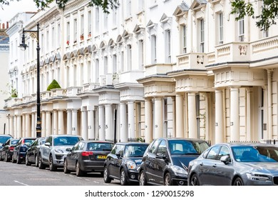 London, UK - June 21, 2018: Street road with cars parked in Pimlico with terraced housing balconies buildings and columns in old vintage historic traditional style flats
