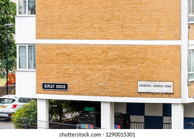 London, UK - June 21, 2018: Churchill Gardens neighborhood road closeup in Pimlico with old vintage historic traditional style flats buildings in summer cheap housing and sign for Ripley House