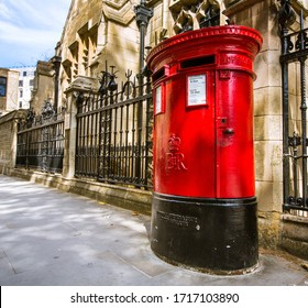 London, UK - June 21, 2018: View of a traditional Royal Mail red pillar box outside a Post Office.