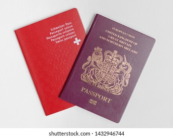 London / UK - June 21st 2019 - Swiss and UK passports, isolated on a white background