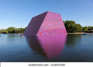 LONDON, UK - JUNE 22, 2018: The Serpentine Lake in Hyde Park with London Mastaba created by Christo.