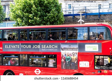 London, UK - June 22, 2018: View on double decker bus in city with ad, advertisement board advertising TotalJobs, online job, work search, recruitment, recruiting platform