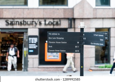 London, UK - June 22, 2018: Neighborhood local store Sainsbury's local sign grocery shopping storefront facade exterior entrance with nobody and directions information pole