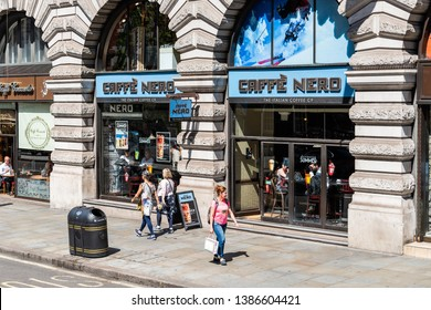 London, UK - June 22, 2018: Road street and cafe Caffe Nero restaurant with people walking on pavement on Piccadilly