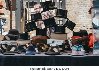 London, UK - June 22, 2019: Vintage hats on sale at stall inside Spitalfields Market, one of the finest surviving Victorian Market Halls in London with stalls offering fashion, antiques and food.