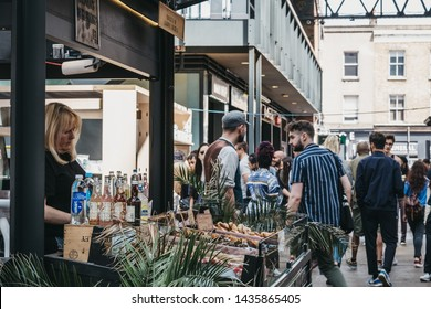 London, UK - June 22, 2019: Bread and sweets stand inside Spitalfields Market, one of the finest Victorian Market Halls in London with stalls offering fashion, antiques and food.