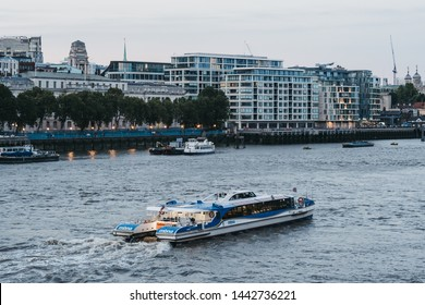 London, UK - June 22, 2019: Thames Clipper boat on River Thames, London, during blue hour. The Clippers are the fastest and most frequent fleet on the River Thames.