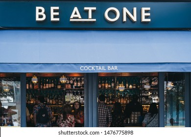 London, UK - June 22, 2019: Exterior of Be At One cocktail bar in Spitalfields, London, people seen through the window. Be At One is a popular chain of cocktails bars that offers masterclasses.