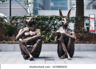 London, UK - June 22, 2019: Dogman and Rabbitgirl with Coffee statue by Gillie and Marc in Spitalfields, London. The statue symbolises unity and promotes diversity, love and acceptance.