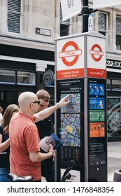 London, UK - June 22, 2019: People looking at the map by Santander Cycles docking station in Spitalfields.Santander cycles are part of transport for London and are a popular way to commute in the city