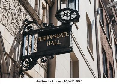 London, UK - June 22, 2019: Bishopsgate Hall sign outside Bishopsgate Institute, a cultural institute in the City of London near Liverpool Street station and Spitalfields market established in 1895.