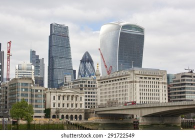 LONDON, UK - JUNE 23: The Walkie-Talkie, Cheese Grater, and Gherkin, seen from London Bridge. June 23, 2015 in London.