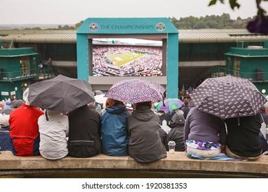 LONDON, UK - June 24, 2011. Wimbledon tennis match. Crowd watching tournament at the stadium on a big screen from Murray Mount or Henman Hill, London, UK