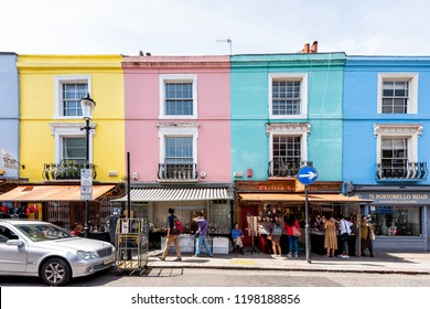 London, UK - June 24, 2018: Neighborhood district of Notting Hill, street, colorful multicolored famous style flats architecture facade, road, people shopping in iconic center, Portobello
