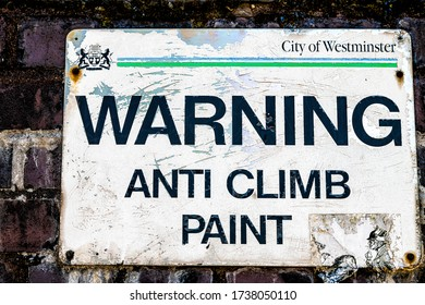 London, UK - June 24, 2018: Road street sign for warning anti climb paint closeup with city of westminster symbol