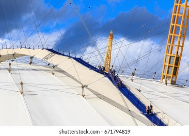 London, UK - June 25, 2017 - A group of people climbing the top of O2 dome in North Greenwich