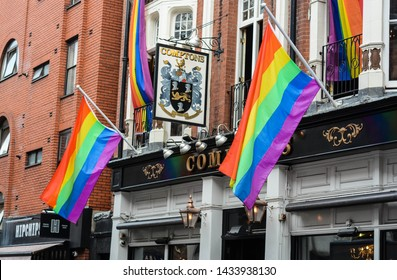 London, UK, June 25, 2019: The exterior of Comptons, Soho's most famous gay bar. LGBT rainbow flags hanging from the building.