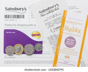 London / UK - June 25th 2019 - Sainsbury's supermarket shopping receipt, voucher, rewards card and money