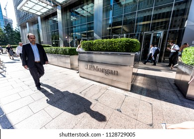 London, UK - June 26, 2018: Entrance exterior to JP Morgan office financial bank building in Canary Wharf Docklands, architecture during morning rush hour, business man walking