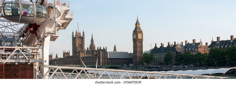 LONDON, UK - JUNE 27, 2010:  Panorama view of London Eye with Houses of Parliament and Big Ben in the Background