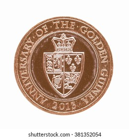 LONDON, UK - JUNE 28, 2014: Celebrative Two British Pound coin for the Anniversary of the Golden Guinea in 2013 vintage
