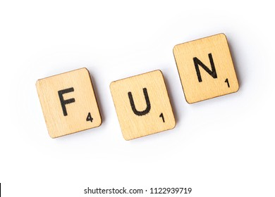 LONDON, UK - JUNE 28TH 2018: The word FUN spelt out with wooden scrabble letter tiles, on 28th June 2018.