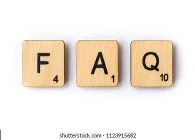 LONDON, UK - JUNE 28TH 2018: The abbreviation FAQ - Frequently Asked Questions - spelt out with wooden letter Scrabble tiles, on 28th June 2018.