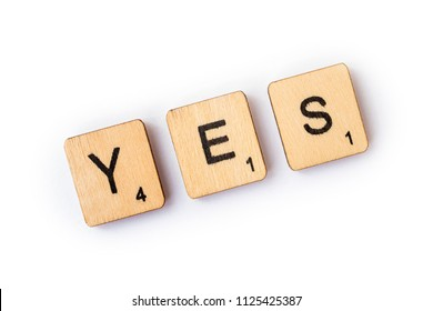 LONDON, UK - JUNE 28TH 2018: The word YES, spelt with wooden letter Scrabble tiles, on 28th June 2018.